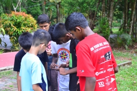 06 Orienteering - the guys having a go at the compass