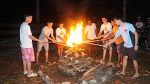 12 commanders and rangers lighting the campfire